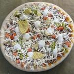 Pizza ennen uuniin laittoa
